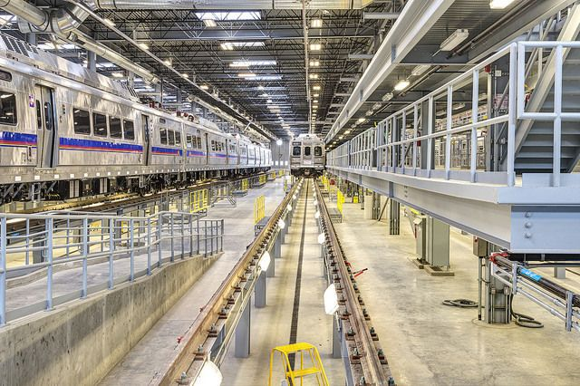 There are six tracks that run through the building on trestles with mechanic bays under the rail...