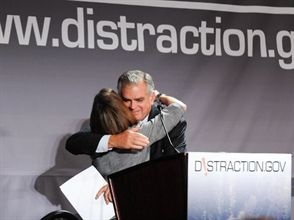 U.S. Transportation Secretary Ray LaHood hugs FocusDriven founder Jennifer Smith as the Distracted Driving Summit closes. State director Derek Graham attended and saw similarity between FocusDriven and the American School Bus Council.