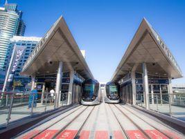 Dubai trams at the Dubai Marina station. Entrance to the train sets is automated to ensure...
