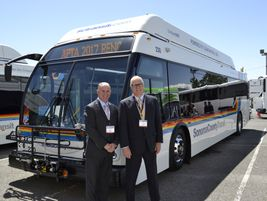 John Walsh, president of REV's bus division (on left), and Mike Ammann, VP, sales, for ENC stand...