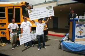 Alexander Chen (center), a student at Irvington High School in Freemont, Calif., submitted the winning essay for IC Bus' 2009 America's Greenest School contest. He received a $5,000 scholarship and his teacher, Clint Johns (to Chen's left), received $3,000 for green school supplies.