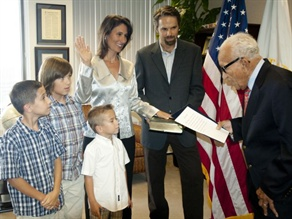 Deborah Hersman, with her family, is sworn in for a second two-year term as chairman of the National Transportation Safety Board.