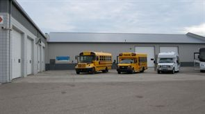 The new service facility at Hoglund Bus Co. Inc.'s main dealership in Monticello, Minn., connects the dealership's parts warehouse and another service facility. The new facility is equipped with a hoist, jacks and a bus wash system.