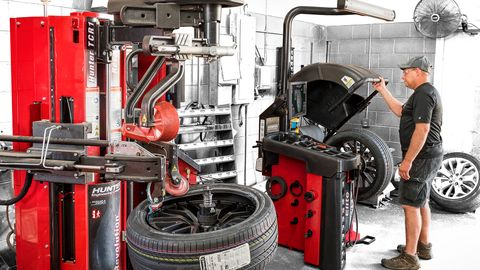 "Hunter's Revolution tire changer with WalkAway capability allows the operator to ""walk away,""..."