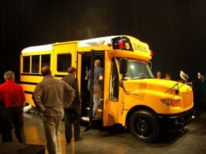 Attendees look over the newly unveiled AE Series school bus, which IC Bus says is the first Type A that is fully integrated.