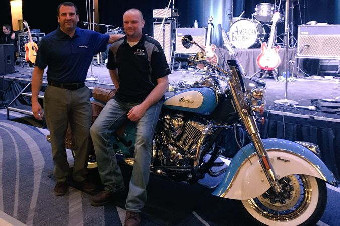Matt Leeper from Falken Tire Corp. gave away this motorcycle to Ron Barlow from FTC Enterprises.