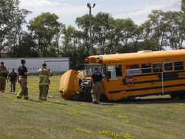 Members of the Saylor Township Fire Department examine the crash demonstration scene. Photo...