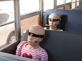 Child-size crash test dummies are placed on a bus as part of a school bus crash demonstration....