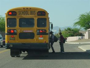 Under California regulations, school bus drivers must turn off their engines immediately at schools and not idle for more than five minutes at other locations.