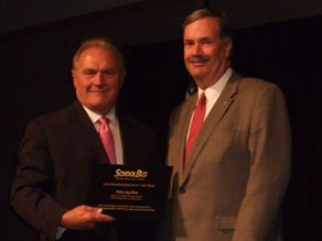 Ohio state director and industry veteran Pete Japikse (right) accepts the 2010 Administrator of the Year award from SBF Publisher Frank Di Giacomo.