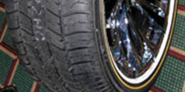 Vogue's new 18-inch high performance tires feature its whitewall and gold stripe design....
