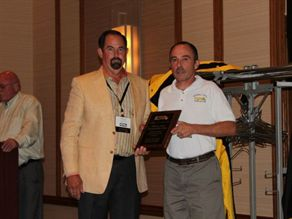NSTA President Donnie Fowler (left) presents Larry Hannon of Centennial School District in Warminster, Pa., with a plaque to commemorate placing first in the Conventional category. This is Hannon's seventh competition win.
