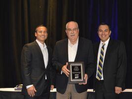METRO and BusCon honored Len Engel (center) for his long-time support and impact on the industry.