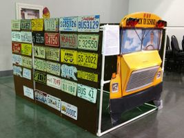 Markham's display won a first-place award at the Automobile License Plate Collectors...