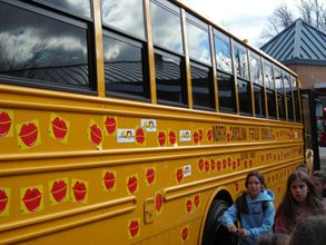 "School bus operations across the nation will hold events around Valentine's Day to honor their drivers as part of the annual ""Love the Bus"" program. Pictured here is a 2007 event in North Carolina during which students placed lip magnets on a bus."