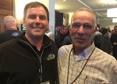 """We brought on a lot of people in 2019,"" said Jeremy Benton (left) with Herman Fowler, Black's Tire outside commercial sales manager, during the trade show. The dealership's commercial tire business, including retreading, is growing."