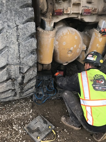 Having the proper equipment makes it easier for OTR tire technicians to safely lift and support machines. The presence of a flat, stable surface also is important. Photos courtesy of Tire Industry Association