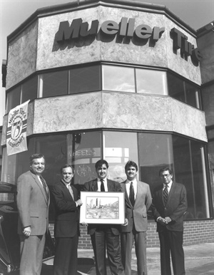 When they were vice presidents of Mueller Tire, Scott (center), Dean (second from right) Mueller, along with their father, Walter, received a painting from Michelin Americas Small Tires commemorating their 75th anniversary. Also pictured in this 1993 photo are Michelin's Dave Clark (far left) and Len Lewin.