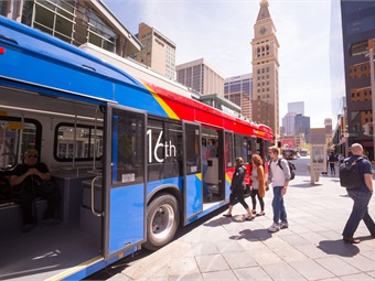 The 45-foot-long, low-floor battery-electric bus features three passenger doors, a separate driver's entry door, and a manual ramp.