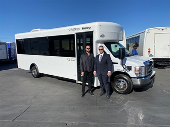 (L to R) JJ Bell, vice president at Kaptyn, and Kaptyn CEO Andrew Meyers standing next to the new all-electric livery vehicle.