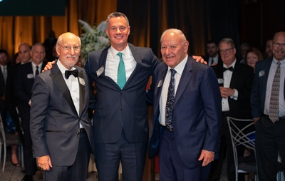 Jerry Finkelstein, left, and Harold Finkelstein, right, celebrated 100 years of Max Finkelstein Inc. with Richard Kramer, chairman, CEO and president of Goodyear Tire & Rubber Co. The company has been a Goodyear dealer for 96 years.