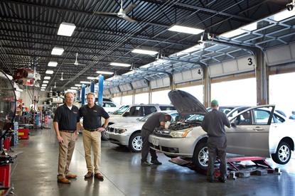 Scott Rhodes, left, and Mark Rhodes, own and operate Plaza Tire, the business their father started in 1963. It has grown into a network of 62 stores and is No. 18 on the MTD 100.