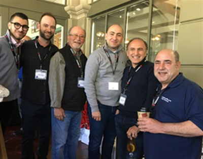 (from left): Armen Tchaghlassian of American Tire Depot, Chris and Tony Guldalian of Grand Prix Tire & Automotive, Arsen Tchaghlassian of American Tire Depot and Avo Kamberian of American Tire Depot pose for a photo with CTDA President Billy Eordekian of 1-800EVeryRom OEM Wheels.