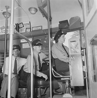 A 1943 photo of Washington, D.C.-based Capitol Transit Co. instructor teaching a female student to operate a one-man streetcar.