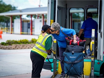 A Palm Tran Connection service vehicle evacuating disabled individuals to the special needs shelter at the South Florida Fairgrounds in West Palm Beach. Palm Tran