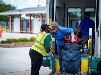 A Palm Tran Connection service vehicle evacuating disabled individuals to the special needs shelter at the South Florida Fairgrounds in West Palm Beach.Palm Tran