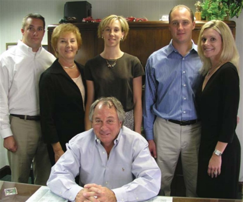 """Members of Bill Williams' family (left to right) are Jason, Sandi, Tracey, Scott, and Stephanie. They all play key roles in the company. """"They work hard, they work long hours, and they enjoy doing it,"""" says Bill."""