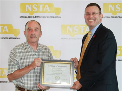 Hannon is seen here with NSTA President Todd Monteferrario at last year's School Bus Driver International Safety Competition. Photo courtesy NSTA