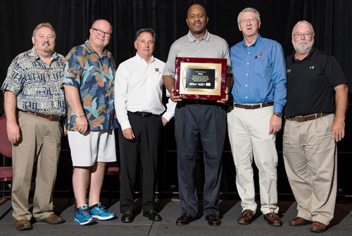Rusty Bishop, CEO of Federated Auto Parts (far left) and Bill Maggs, CEO of National Pronto Association (far right) present top supplier honors to the Remy team (left to right): Gary Bostic, Frank Doria, Dave Nichols and Kent Talley.