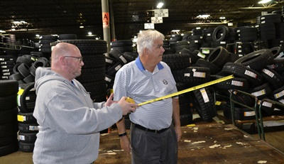 Tom Geiger, right, and his son-in-law, Rob Kuhr, address an issue at the Toledo warehouse. Kuhr is warehouse coordinator.