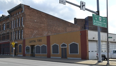Capital Tire's headquarters remains a museum to earlier times. Founder Ben Geiger first occupied the taller section on the left, located 500 feet from the original building, in 1923. The 1919 location was made into a city parking lot in the early 1950s.