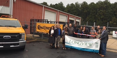 The Longview Chamber of Commerce Reach Team joins BestDrive employees at the celebrate the ribbon-cutting ceremony. Store Operations Manager Frankie Hendrix cuts the ribbon.