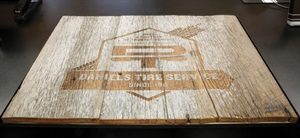 We used 100-year-old barn wood from Michigan and laser cut a new logo and placed it in the center of the counter.