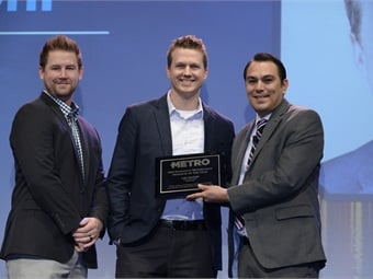 METRO Magazine's Innovative Operator of the Year, Arrow Stage Lines' COO Luke Busskohl (center) and Marketing Manager Brandon Osborn (left) receiving the award from METRO Managing Editor Alex Roman (right).