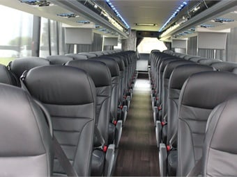 Passengers will recognize the luxury before they even enter the coach with the two-tone white and grey paint and beautiful graphics around the coach.