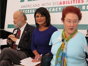 Pictured from left: AC Transit Board President Chris Peeples; Mistress of Ceremonies Robert Gonzales; and Keynote Speaker Jan Garrett, program manager, Pacific ADA Center wait for the program to begin.