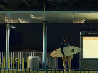 The commercial was filmed over two days in Los Angeles and tells the story of a young surfer from South L.A. Screenshot via AECOM