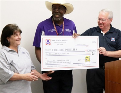 Freddie Phillips (center), a bus driver for East Baton Rouge (La.) Parish School System, was presented with the second annual AMF-Bruns National Special-Needs School Bus Driver of the Year Award. Photo courtesy AMF-Bruns