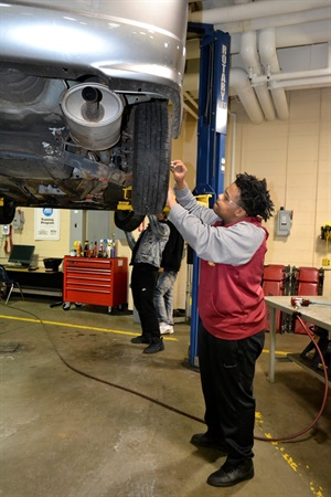"""Ty'aire """"Tiggy"""" Solomon is among the students learning hands-on skills as part of a two-year automotive technology curriculum in Akron."""