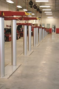 In-ground lifts are preferred by many large shops and make clean-up easy at the end of the day. Photo courtesy of Challenger Lifts.