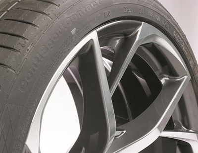 Raised spokes are a new wheel style that will require technicians to set the tire changer's mount head higher to avoid damaging the wheel and the mount head, according to Hunter. A wheel on an Acura NSX is pictured.