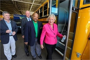 From left to right: State Senator Rusty Glover;Blue Bird Chief Commercial Officer Dale Wendell; MCPSS Transportation Director Pat Mitchell; and Lt. Gov. Kay Ivey boarding one of the district's new propane autogas buses.