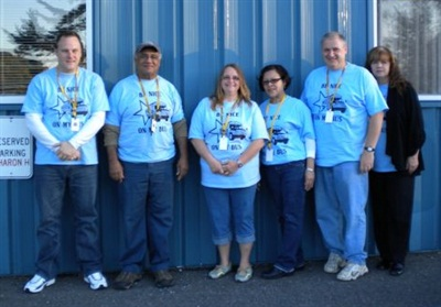 "Staff at All-Star Transportation's Seymour, Conn., location wear blue T-shirts with a call to ""Be Nice on My Bus!"" as part of the World Day of Bullying Prevention. From left: Manager Steve Gardner and drivers Luke Ishman, Mary Banks, Ana Molina, Robert Stow and Debra MacGregor."