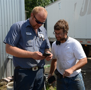 After weighing the tractor, Alton Degenhardt (left) discusses the correct inflation pressure with his customer, Patrick McHugh, who farms 2,000 acres.