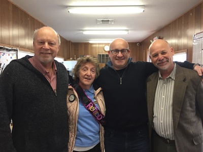 Ann Kania (second from left), a driver for We Transport Inc., has retired after more than four decades of service.Shown here from left is Bart Marksohn, president and owner of We Transport; Brian Marksohn, director; and Carmen Tomeo, CEO. Photo courtesy We Transport Inc.