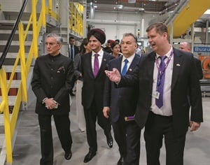 Apollo Chairman Onkar Kanwar, second from left, tours the new $500 million tire manufacturing facility, which took two years to build.